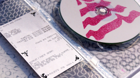 inner of packaging, with disc and informative insert-card